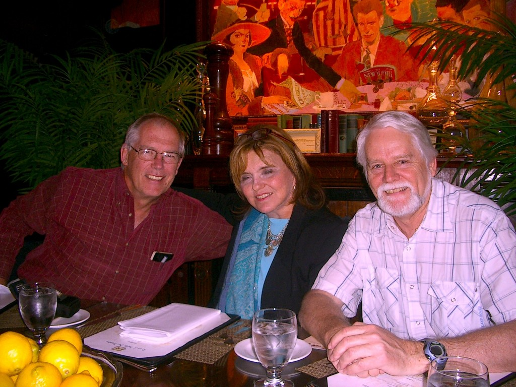 Seated at the round table are Stanley (left), Michael (right), with their agent, Marly Rusoff
